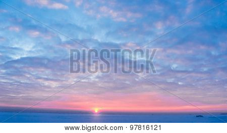 Sunset in the Arctic Frozen Horizon