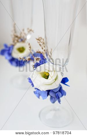 Two wedding glasses on tender background