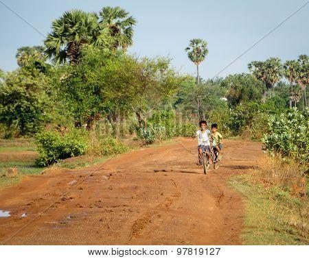 Cambodian Boys Riding Bike
