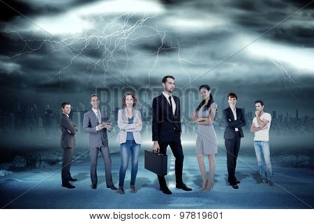 Business team against stormy sky with tornado over road