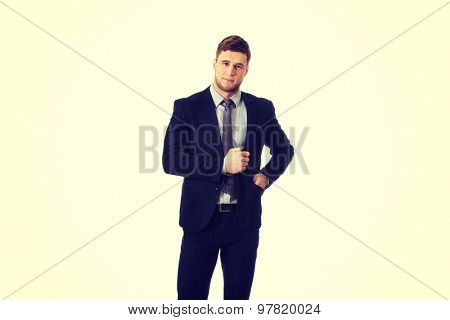 Young handsome businessman in business suit.