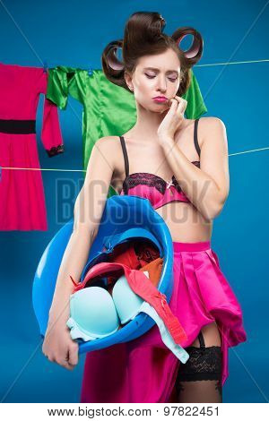 pin-up girl with a basket with the laundry
