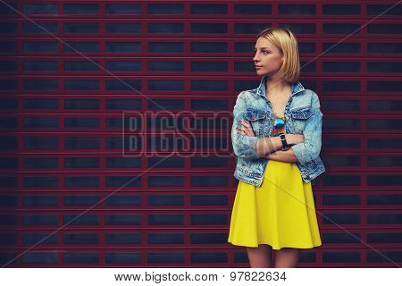 Portrait of attractive young woman standing on blank copy space background for your text message