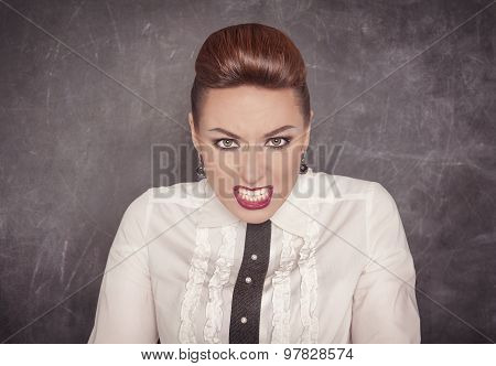 Angry Teacher On The Blackboard Background