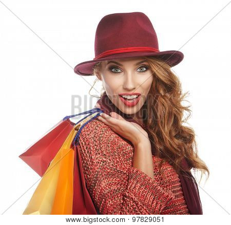 Shopping woman holding bags . smiling girl portrait on white studio wall background. Happy fashionable woman.