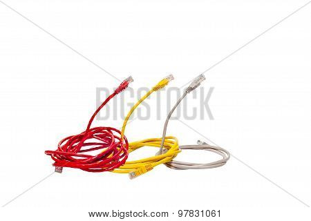 Three multicolored network cables in the form of a cobra snake