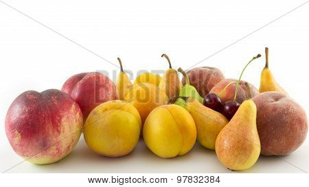 Fresh Fruit Arranged On White Background