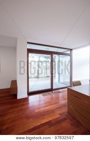 Spacious Interior With Wooden Floor