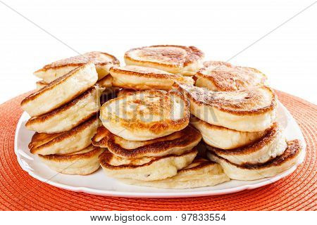 Homemade flapjacks on a plate, Isolated white background