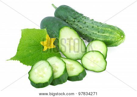 organic cucumber with leaf and slices of cucumber isolated on white