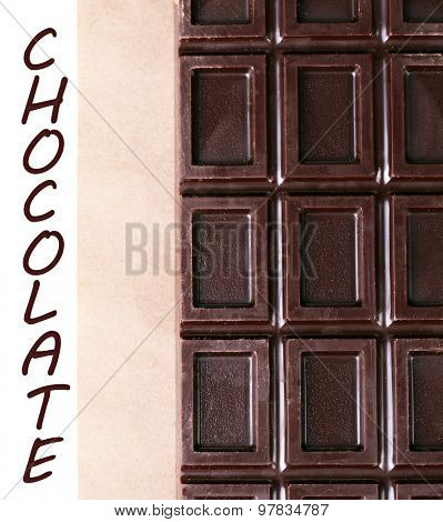Bar of chocolate on craft paper and space for text