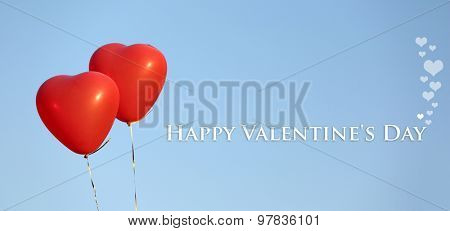 Love heart balloons on blue background
