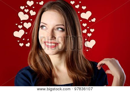 Attractive woman on red background with hearts