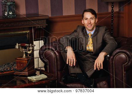 Businessman Sitting In A Leather Executive Chair.