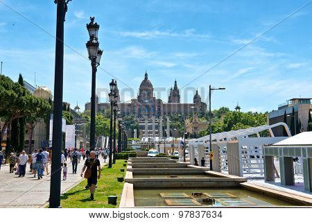 BARCELONA, SPAIN - MAY 02: External frontal view of the National Museum of Catalan Art, Barcelona, Spain, a historical cultural landmark, with tourists walking. May 02, 2015 in Barcelona Spain