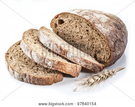Sliced loaf of bread on a white background.