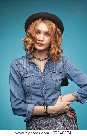 Young Stylish Adult Girl On A Blue Background