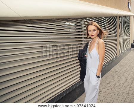 Fashionable Woman Model On Hi-tech Urban Background