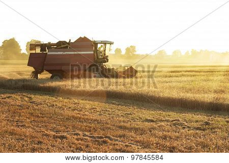 Farmer in tractor driving to the field