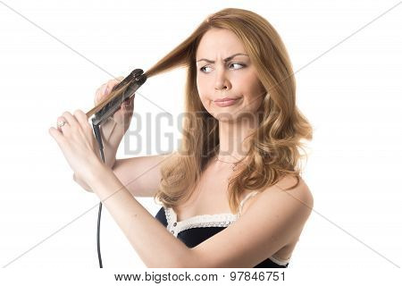 Young Woman Straightening Frizzy Hair