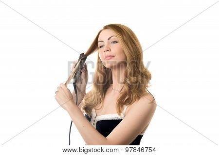 Young Woman Straightening Curly Hair
