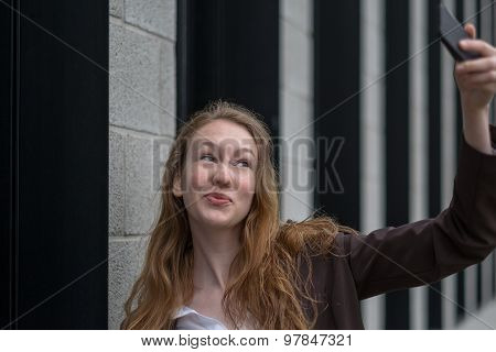 Playful Young Woman Taking A Selfie