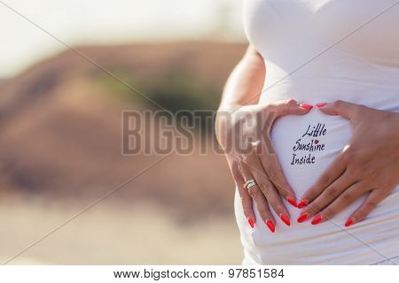 Pregnant Young Woman Relaxing Near The Beach