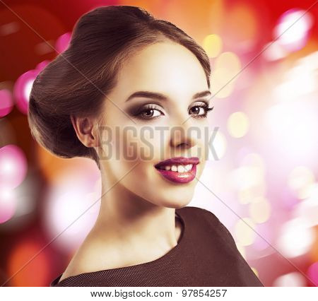 model with retro makeup and hair style against light grey studio background, isolated