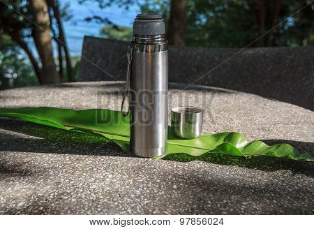 Open Thermos On A Stone Table