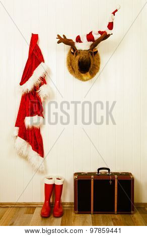 Old decoration for christmas in vintage style in red white and brown colors with santa.