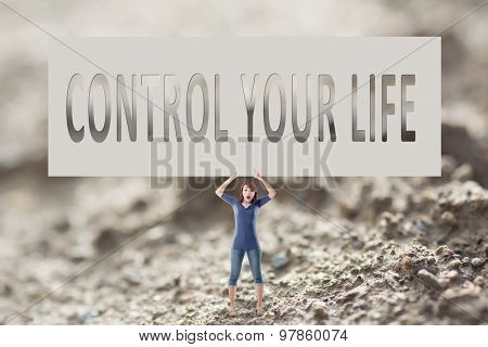 Control your life, words on blank board hold by a young girl in the outdoor.