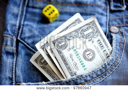 One dollar in pocket denim and a dice