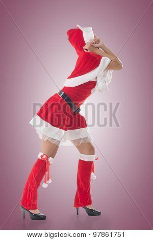 Christmas girl pull something, full length portrait.