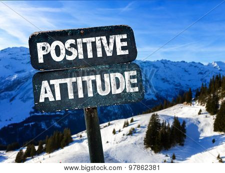 Positive Attitude sign with winter landscape on background