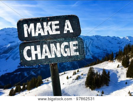 Make a Change sign with winter landscape on background