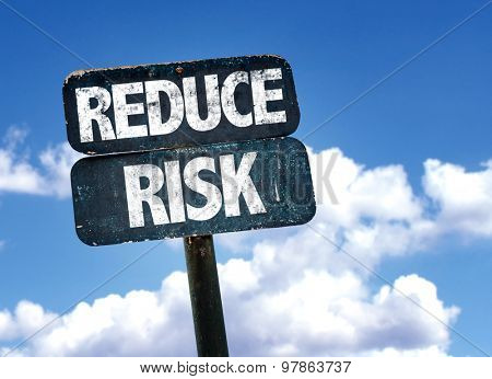 Reduce Risk sign with clouds on background