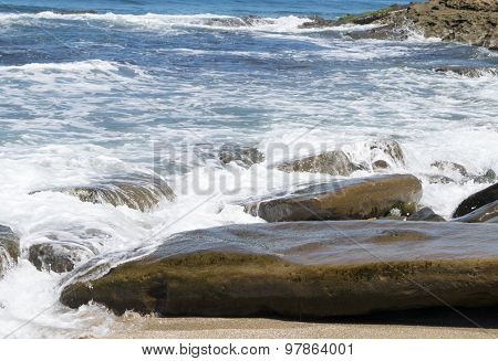 Ocean waves at shoreline from above