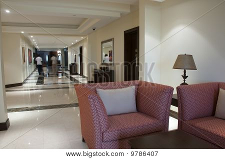 Sofa In The Corridor With People