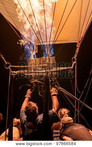 Crew igniting the burner of hot-air balloon