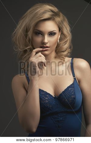 Sensual Beautiful Blonde Woman Posing In Sensual Lingerie. Girl With Long Curly Hair.