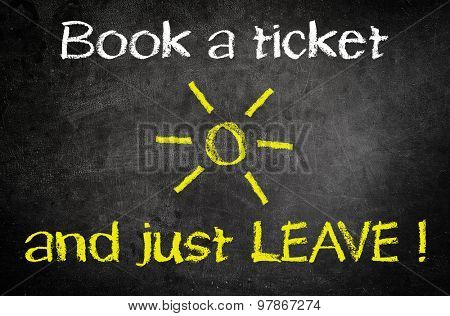 Book a Ticket and Just Leave Message for Summer Vacation Concept Written on a Black Chalkboard with Glowing Sun Drawing in the Middle of the Texts.