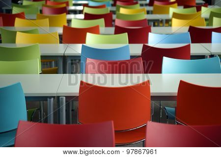 Rows of seats with colorful chairs