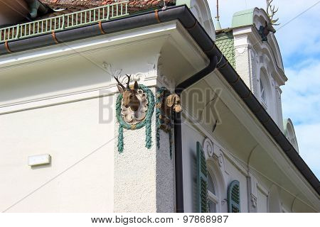 Heads Mounted On Side Of The Building