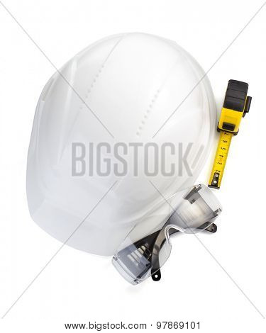 construction helmet and safety glasses on white background