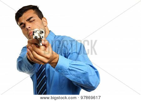 Young businessman with gun