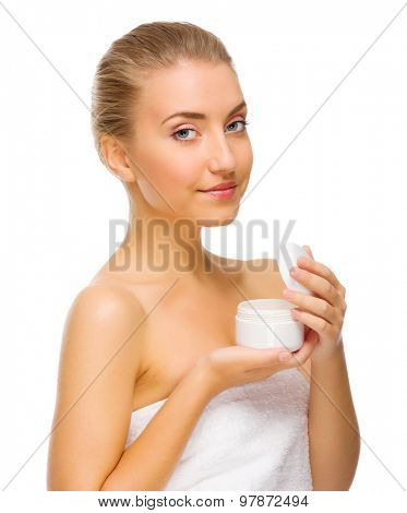 Young girl with body cream jar isolated