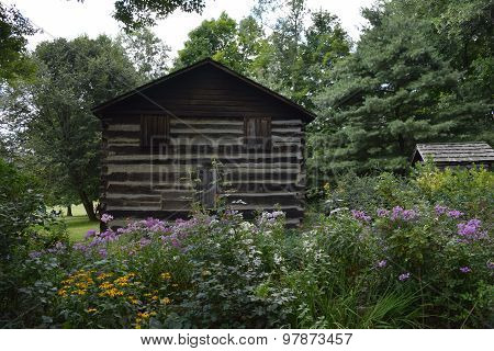 log cabin with flower garden