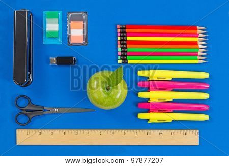 Basic Supplies For Office Or Back To School On Blue Background