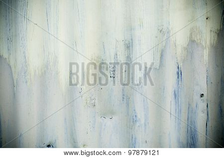 Zinc wall with white cracked paint
