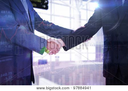 Handshake in agreement against stocks and shares